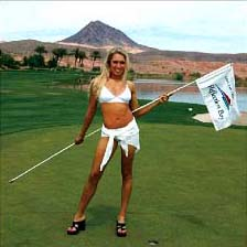 Natalie Gulbis in white sexy bikini, holding a flag in a Golf Course form 2006 Calendar